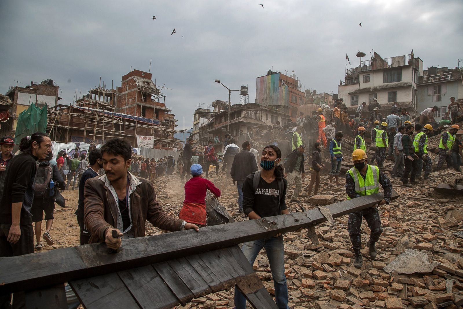 People Helping to Clear the rubble